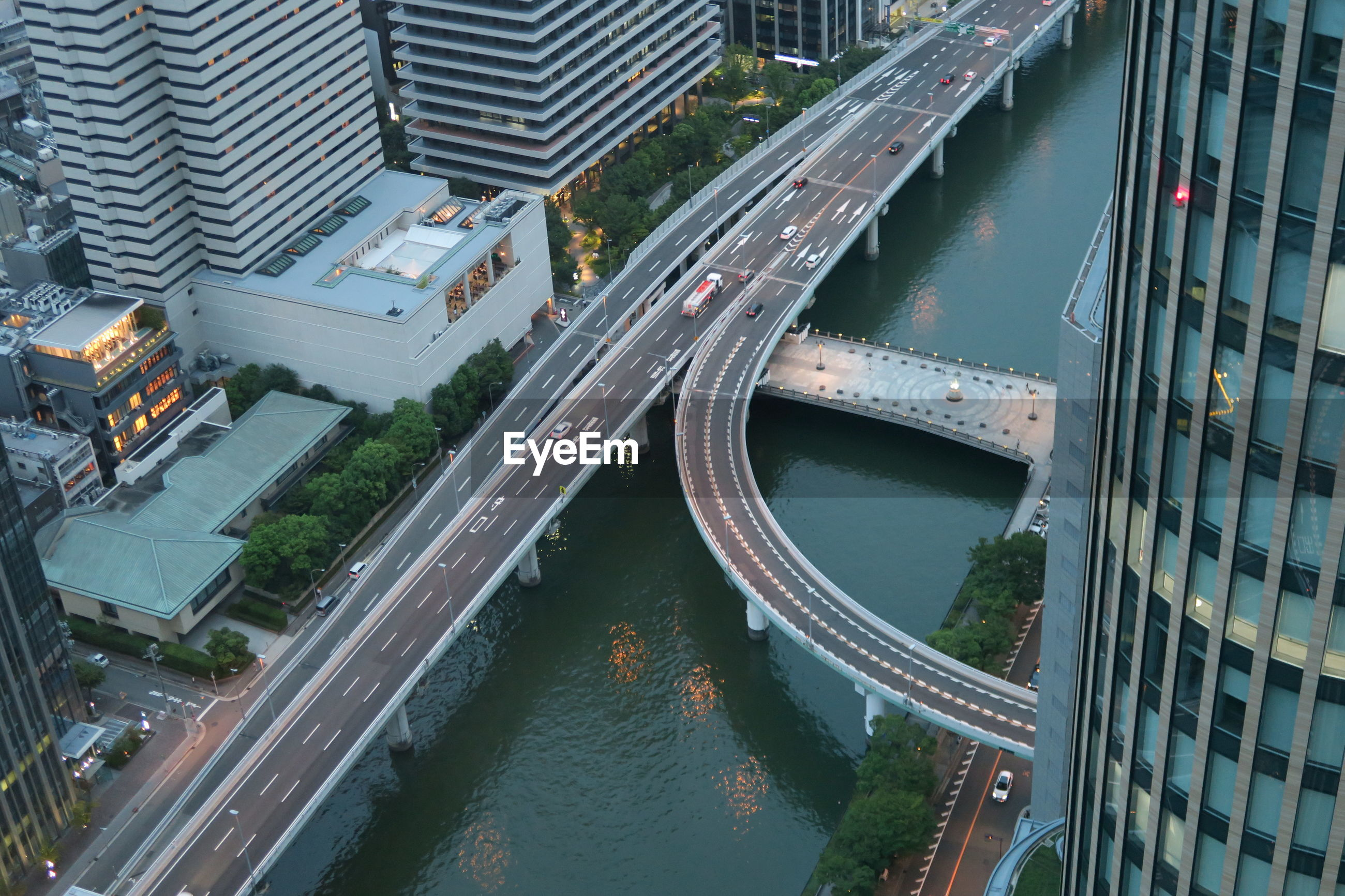 HIGH ANGLE VIEW OF ELEVATED ROAD BY CANAL