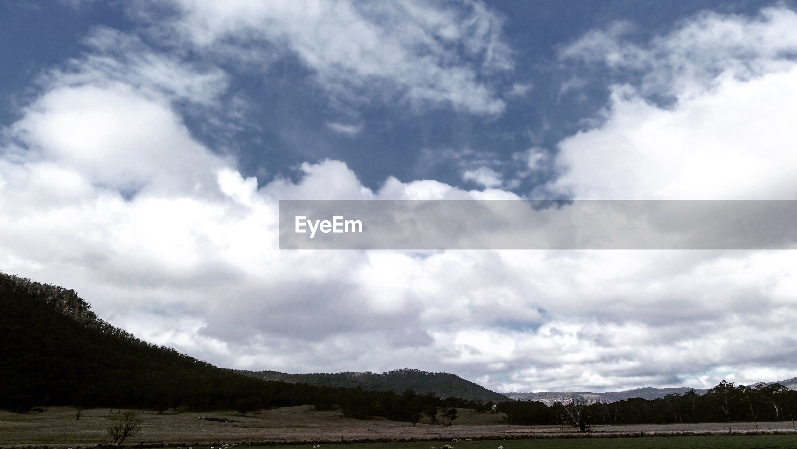 tranquil scene, tranquility, scenics, sky, beauty in nature, non-urban scene, landscape, mountain, cloud, cloud - sky, nature, idyllic, cloudscape, water, day, mountain range, cumulus cloud, majestic, sea, remote, outdoors, tourism, solitude, vacations, atmosphere, cloudy, atmospheric mood, countryside, dramatic sky, no people