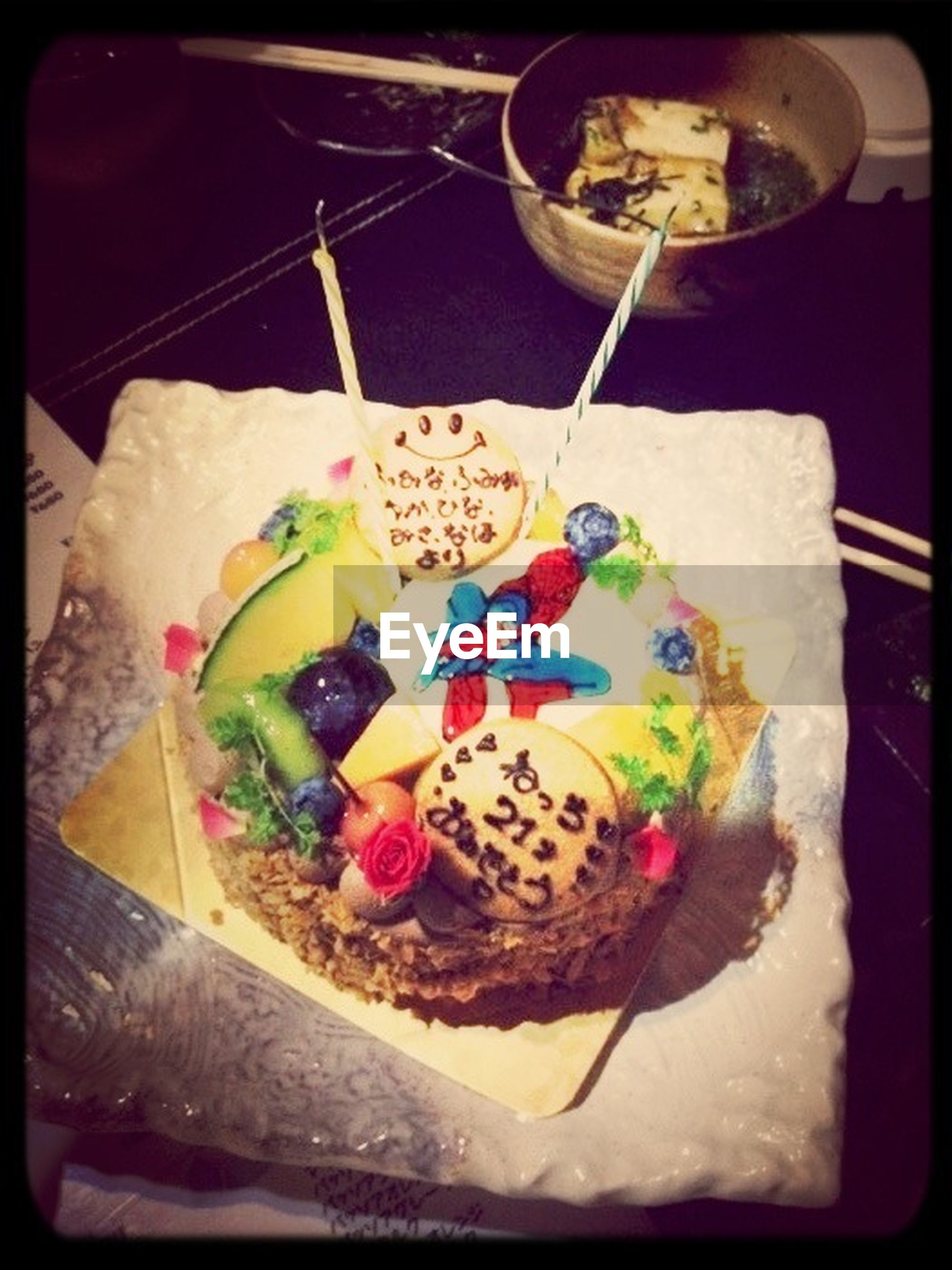 food and drink, food, indoors, sweet food, freshness, ready-to-eat, dessert, indulgence, still life, unhealthy eating, table, plate, cake, temptation, serving size, high angle view, fruit, slice, close-up