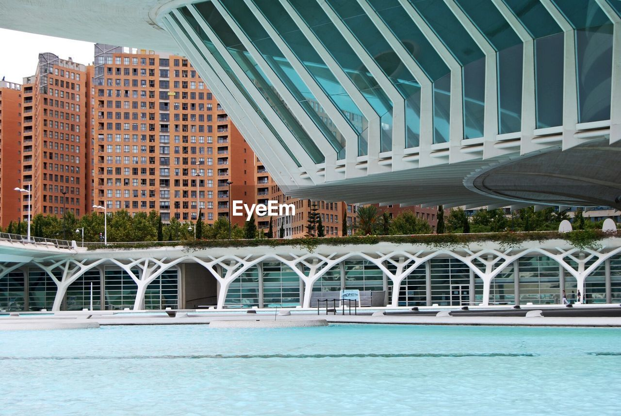 architecture, bridge - man made structure, built structure, building exterior, connection, modern, city, outdoors, day, water, skyscraper, no people, cityscape, sky