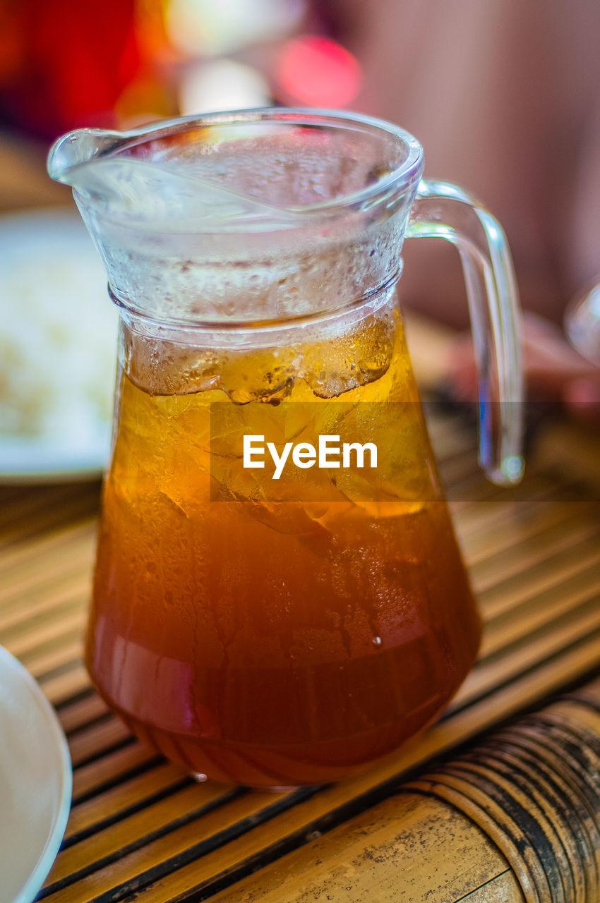 Close-Up Of Lemon Tea In Jug On Table