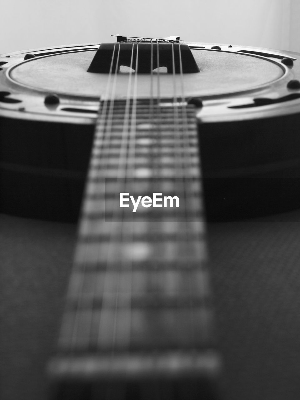 music, musical instrument, musical equipment, arts culture and entertainment, string instrument, musical instrument string, selective focus, string, guitar, indoors, no people, close-up, acoustic guitar, fretboard, still life, woodwind instrument, wind instrument, pattern, studio shot