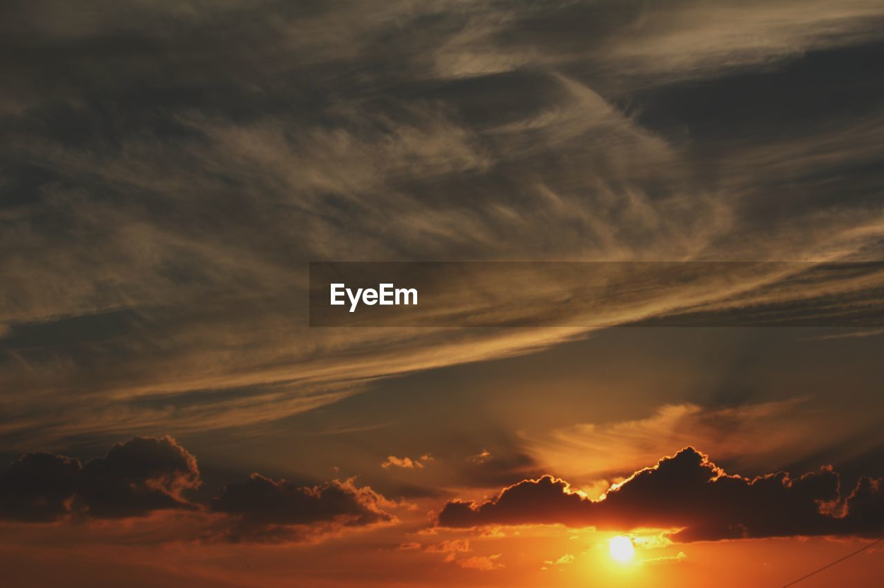 cloud - sky, sky, sunset, scenics - nature, beauty in nature, tranquility, tranquil scene, orange color, no people, idyllic, nature, dramatic sky, low angle view, outdoors, cloudscape, non-urban scene, sunlight, backgrounds, sun