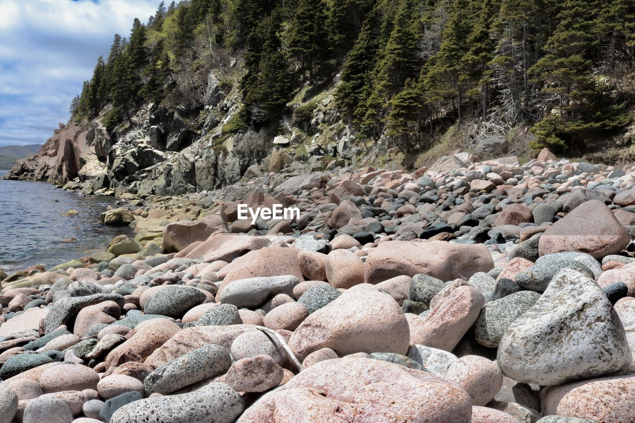 Stones At Lakeshore By Mountain