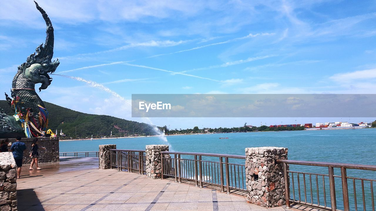 water, railing, day, sky, outdoors, cloud - sky, nature, sea, statue, no people, sculpture, scenics, beauty in nature