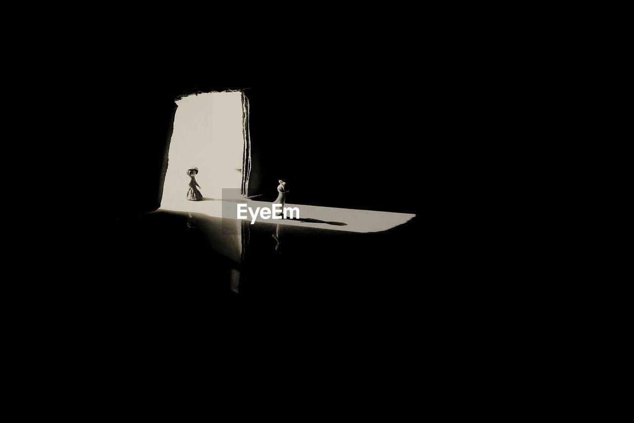 VIEW OF AIRPLANE IN ILLUMINATED NIGHT