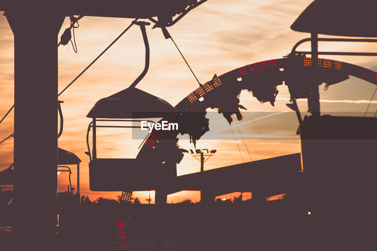silhouette, sunset, low angle view, sky, no people, outdoors, close-up, day