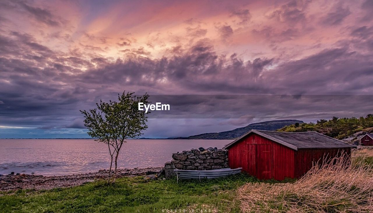 cloud - sky, sky, no people, nature, outdoors, sunset, architecture, beauty in nature, scenics, tranquility, tranquil scene, tree, built structure, sea, day, water