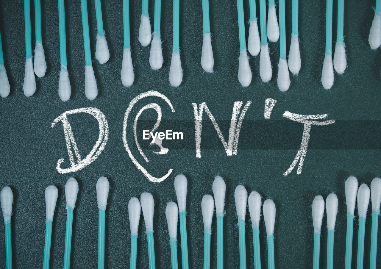 Directly Above Shot Of Cotton Swabs With Dont Text
