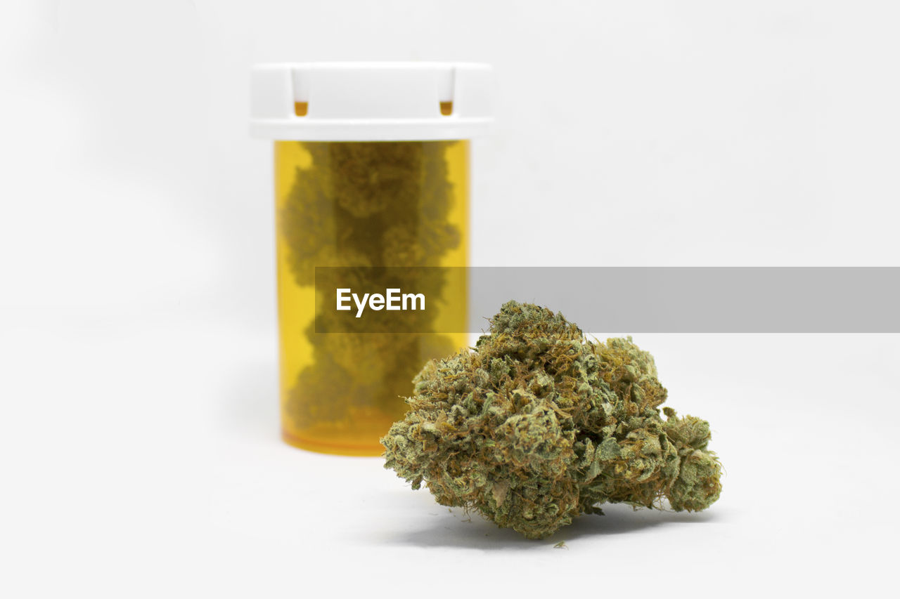 medicine, healthcare and medicine, studio shot, indoors, white background, close-up, herbal medicine, no people, marijuana - herbal cannabis, plant, food and drink, still life, food, nature, container, green color, freshness, herb, cannabis plant, narcotic, medical cannabis