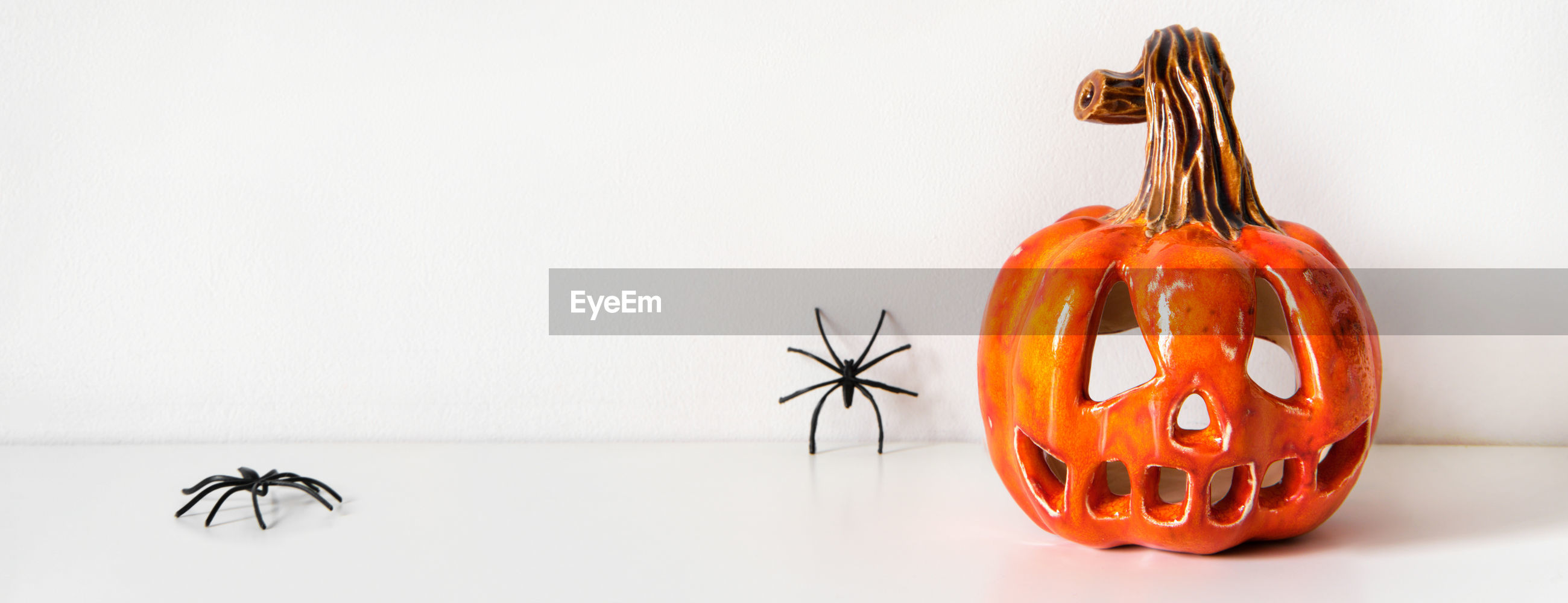 CLOSE-UP OF PUMPKIN AGAINST COLORED BACKGROUND
