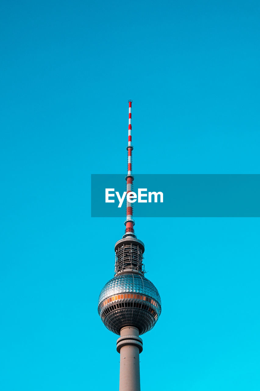 tall - high, architecture, communication, built structure, tower, clear sky, low angle view, blue, television tower, building exterior, travel destinations, no people, travel, day, outdoors, modern, technology, sky, city