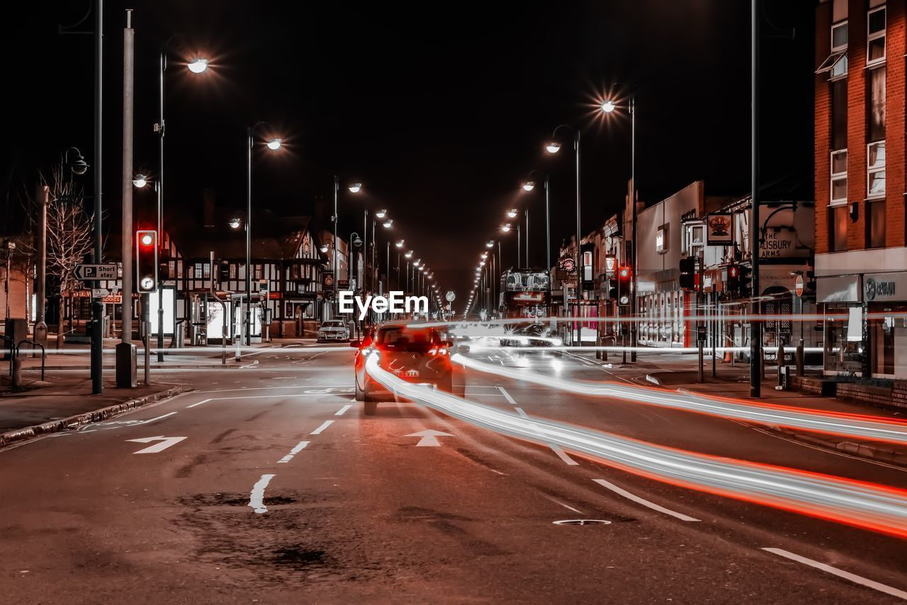 illuminated, street, night, city, road, transportation, street light, long exposure, motion, light trail, architecture, blurred motion, building exterior, lighting equipment, car, city street, motor vehicle, mode of transportation, built structure, city life, no people, outdoors, light