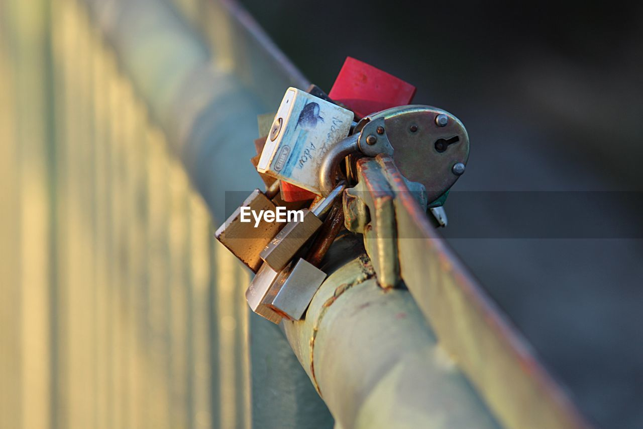 padlock, lock, metal, safety, selective focus, close-up, protection, security, love, love lock, day, railing, focus on foreground, no people, positive emotion, emotion, outdoors, hope - concept, belief, fence