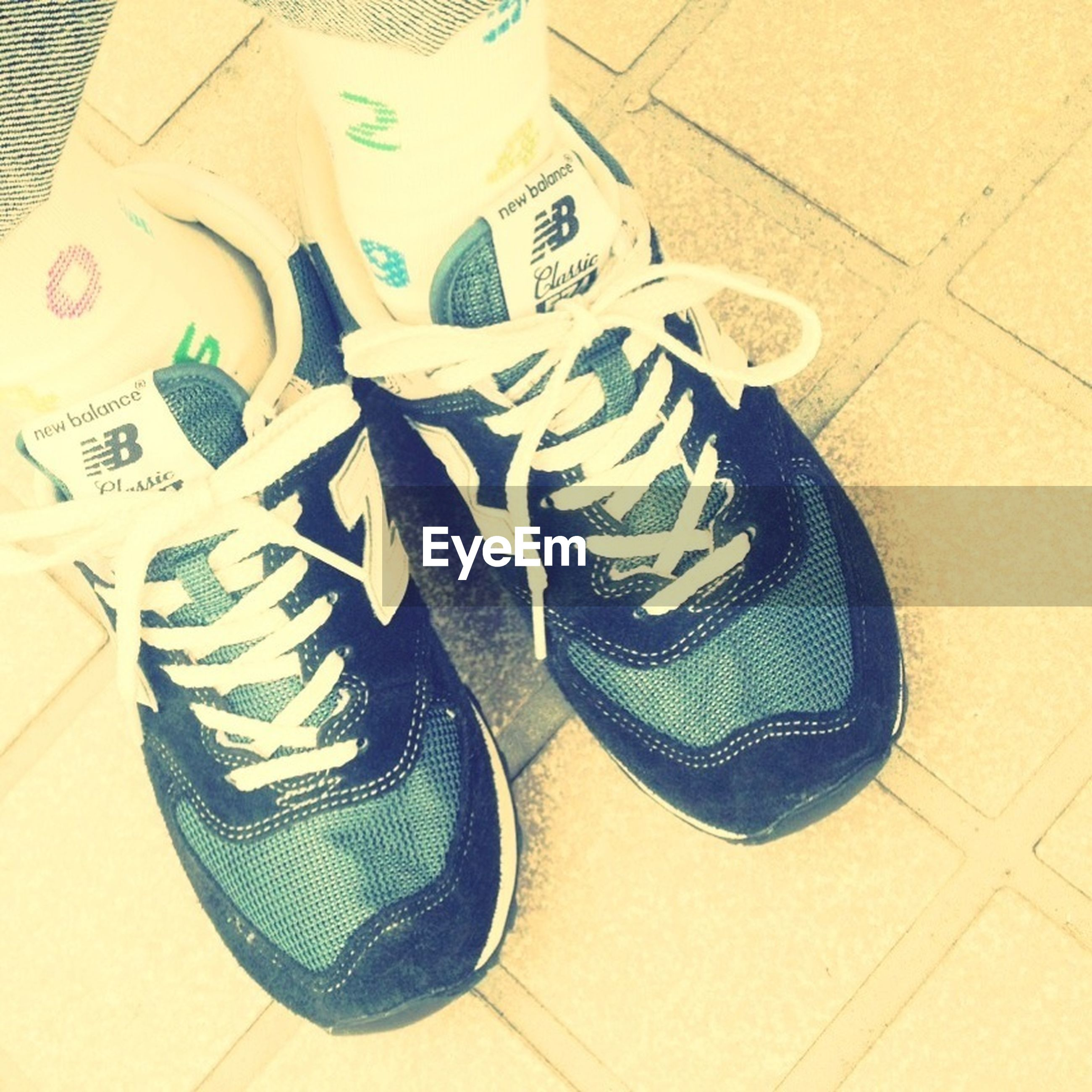 indoors, high angle view, still life, shoe, table, flooring, close-up, directly above, communication, footwear, text, tiled floor, pair, paper, low section, absence, no people, jeans, floor, choice