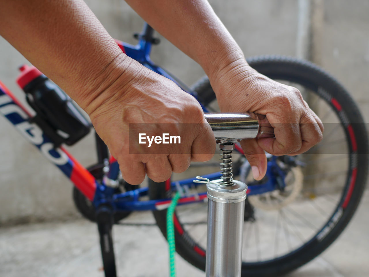 Close-up of person filling bicycle tire