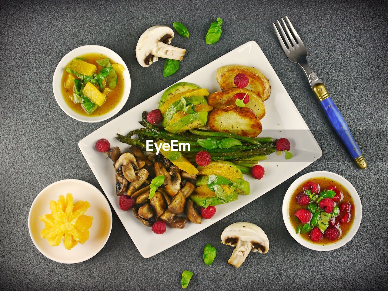 food and drink, food, freshness, healthy eating, ready-to-eat, vegetable, kitchen utensil, meal, fruit, indoors, eating utensil, wellbeing, table, fork, still life, plate, directly above, high angle view, no people, household equipment, table knife, garnish