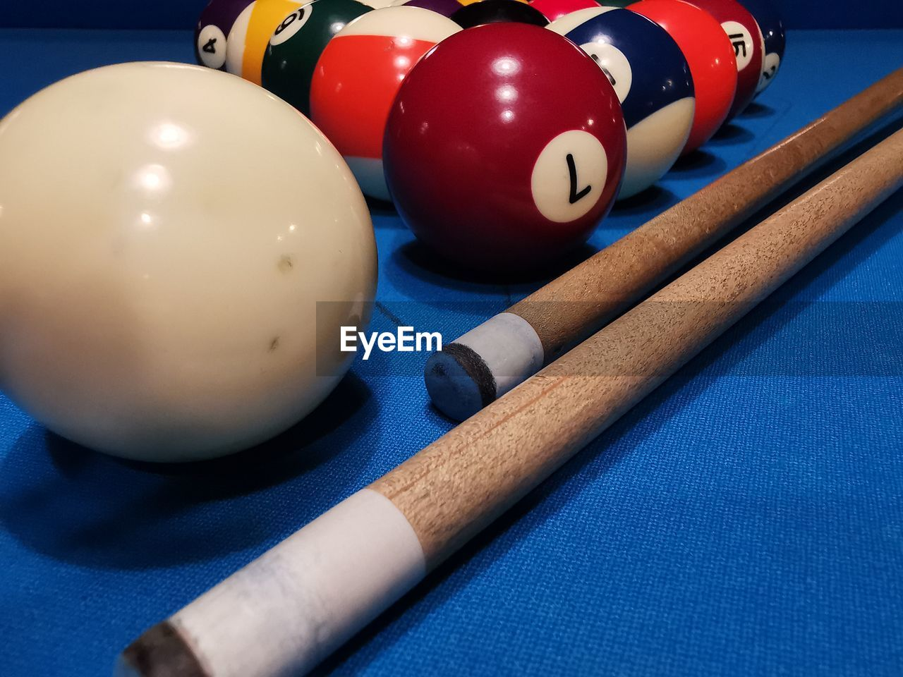 sport, ball, pool ball, table, pool table, sports equipment, pool - cue sport, sphere, pool cue, still life, indoors, blue, snooker, no people, leisure activity, close-up, leisure games, number, high angle view, relaxation