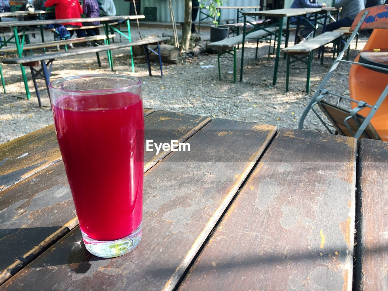 Close-Up Of Beetroot Juice In Glass On Table At Outdoor Restaurant