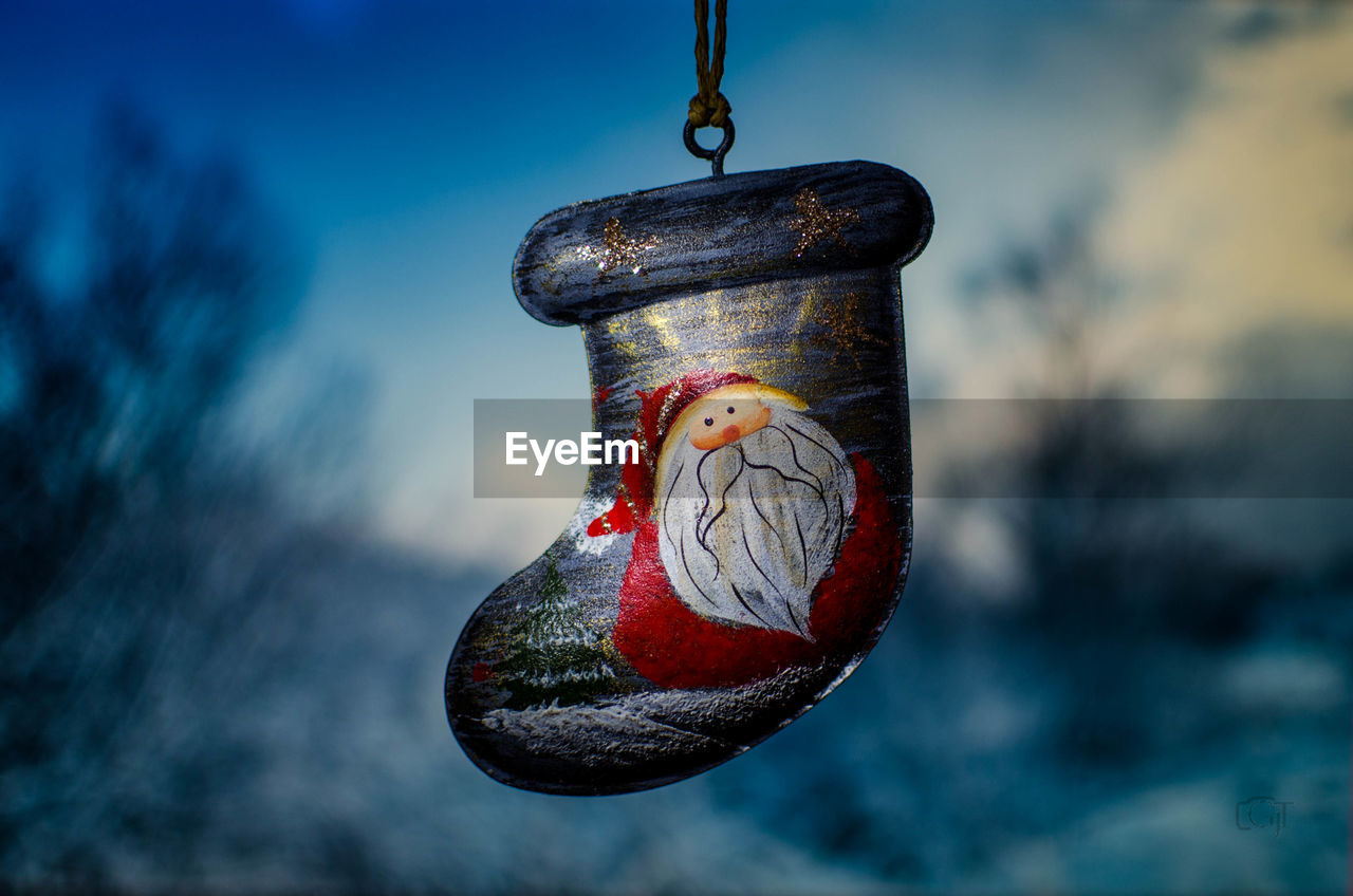 focus on foreground, hanging, close-up, no people, day, nature, outdoors, metal, water, rope, bird feeder, animal, red, animal themes, sky, blue, fishing hook, vertebrate, bird