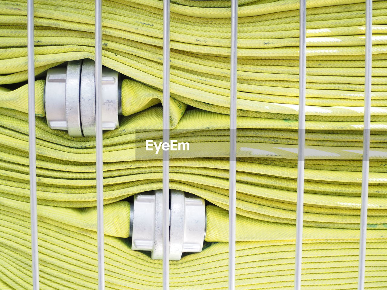no people, wall - building feature, equipment, backgrounds, pattern, full frame, green color, close-up, hanging, metal, cleaning equipment, broom, day, electricity, indoors, built structure, technology, connection, protection, gardening, home improvement