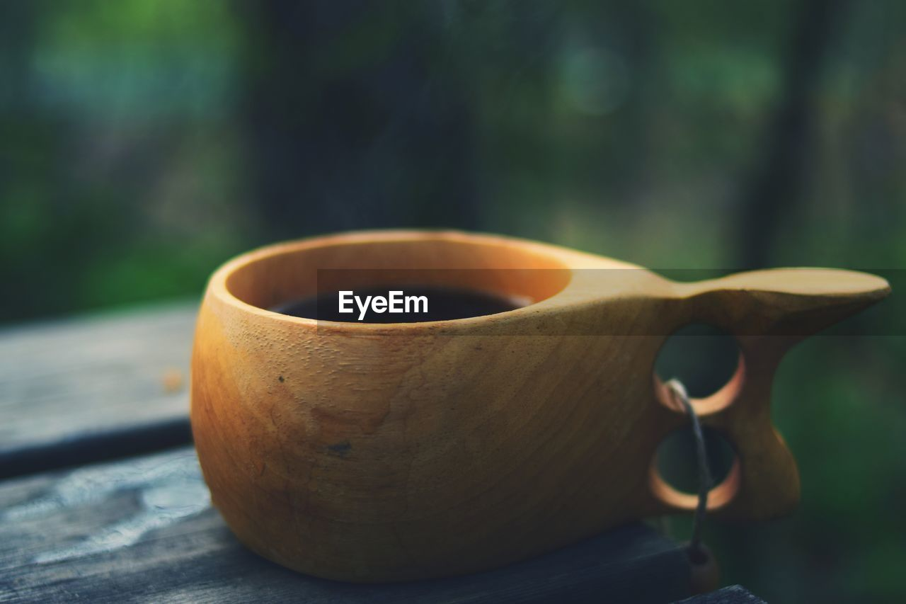focus on foreground, wood - material, close-up, food and drink, day, cup, no people, drink, refreshment, coffee, mug, still life, food, table, outdoors, selective focus, nature, coffee - drink, freshness, coffee cup, tea cup
