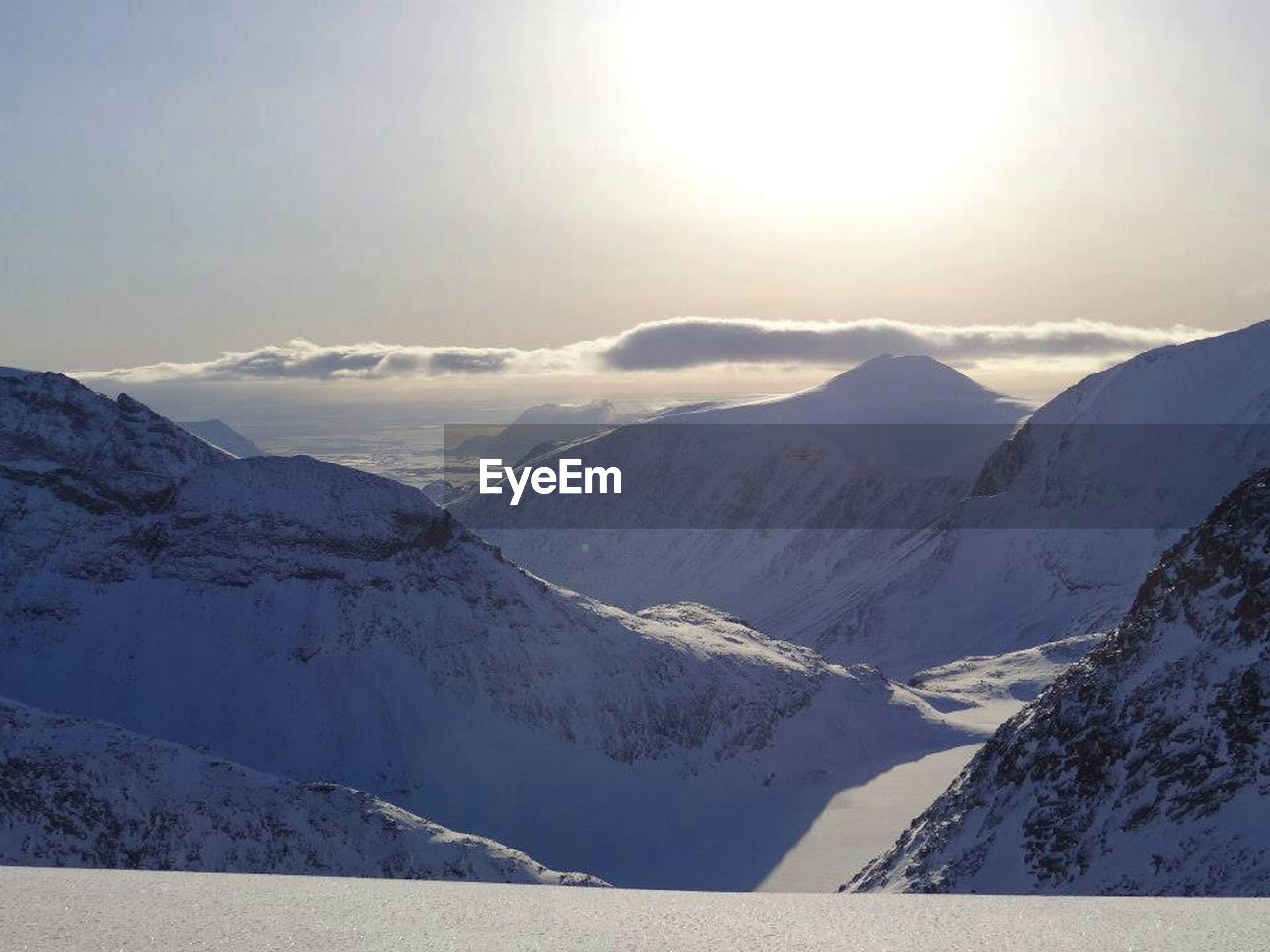 mountain, snow, winter, cold temperature, mountain range, tranquil scene, scenics, tranquility, beauty in nature, season, snowcapped mountain, landscape, nature, weather, sky, sun, idyllic, covering, non-urban scene, sunlight