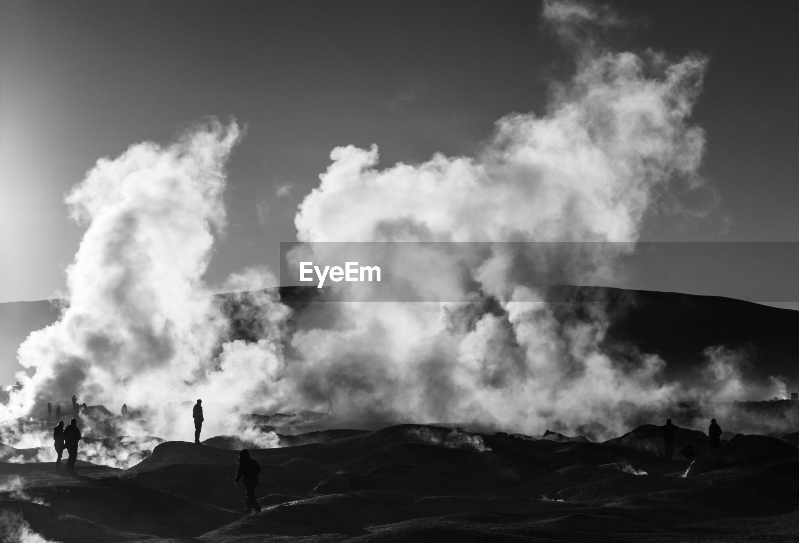 VIEW OF SMOKE EMITTING FROM MOUNTAIN