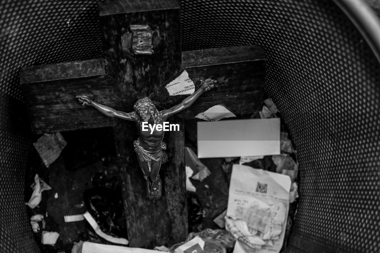 High Angle View Of Crucifix In Garbage Bin