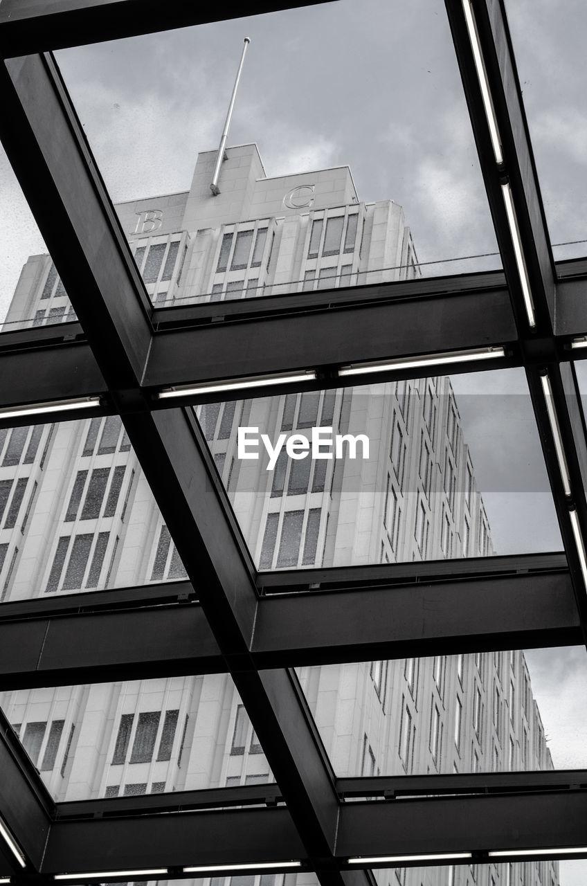 Skyscraper seen through glass ceiling