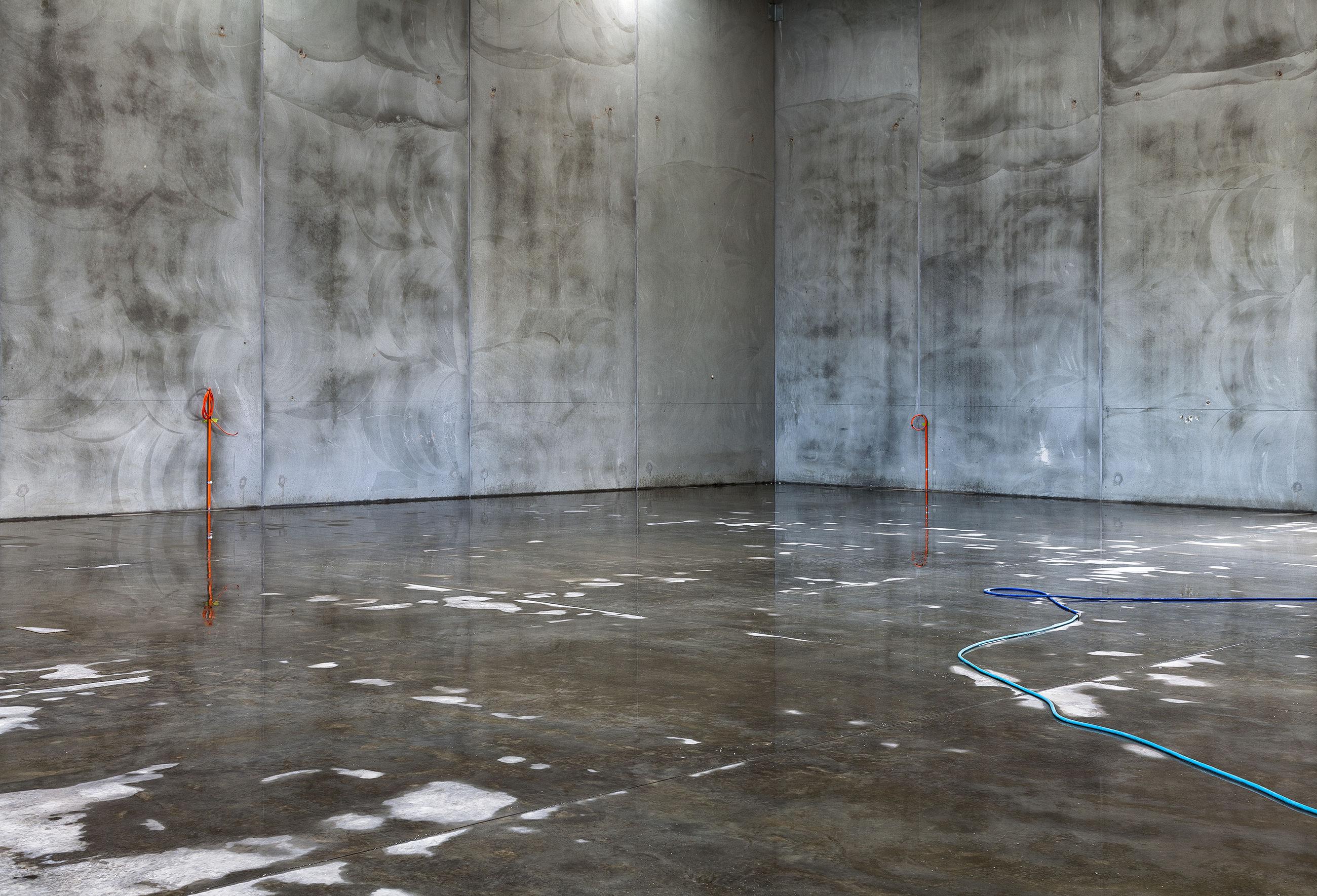 Wet flooring in illuminated building
