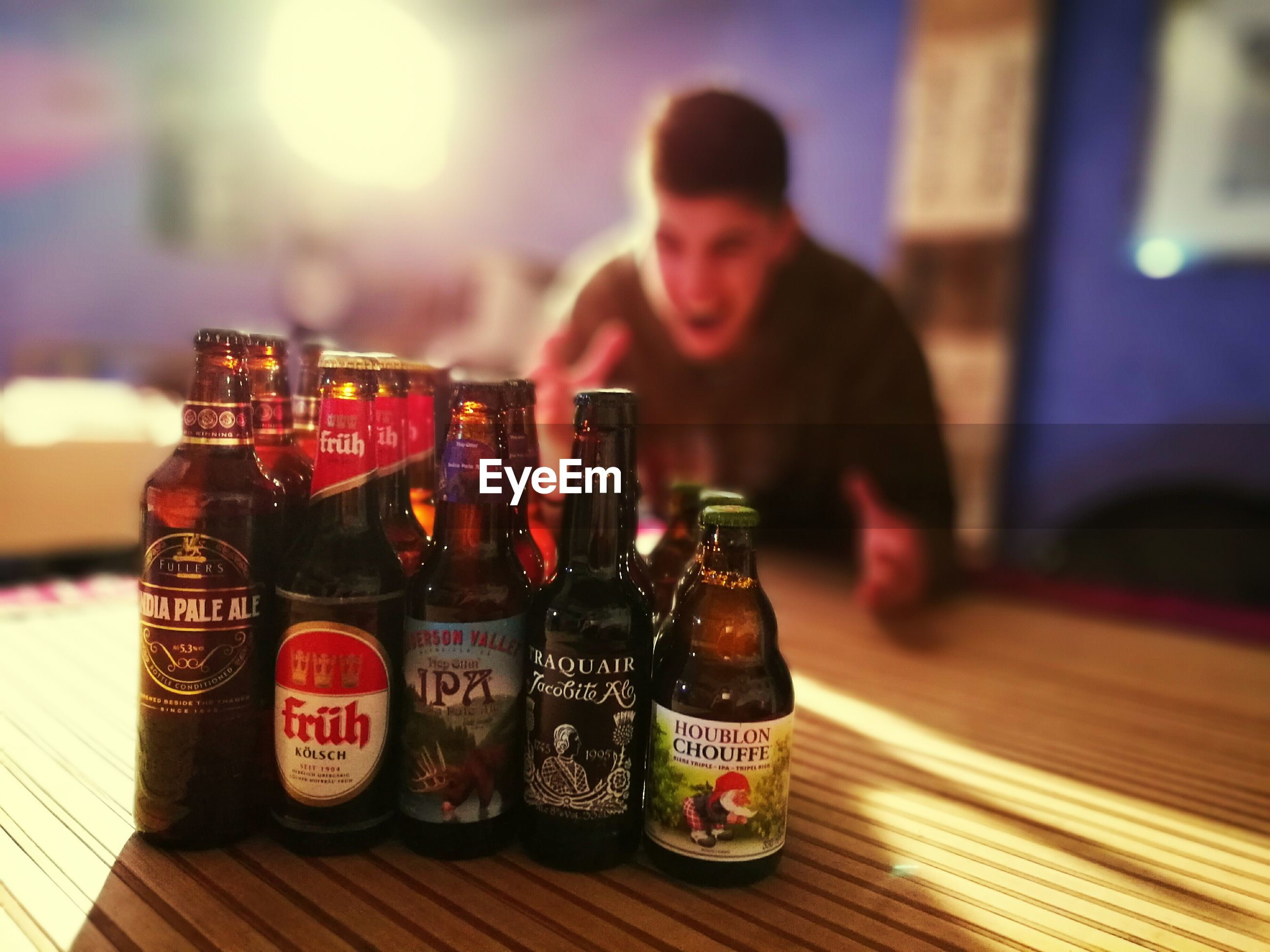 alcohol, drink, beer - alcohol, only men, beer bottle, one person, indoors, bar - drink establishment, men, lifestyles, bar counter, table, happy hour, adults only, refreshment, one man only, people, drinking glass, adult, nightlife, pub, freshness, young adult, day