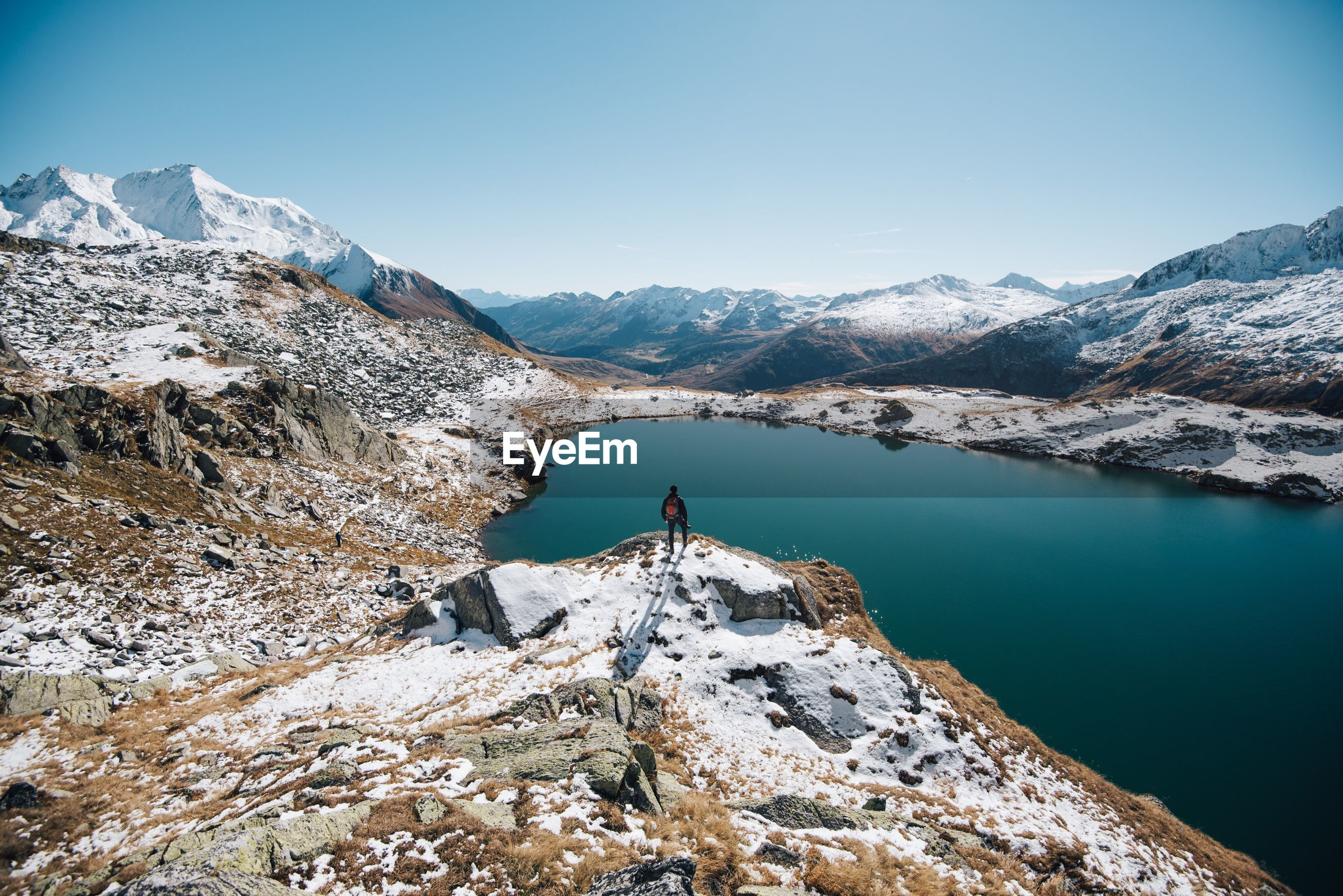 mountain, snow, tranquil scene, cold temperature, lake, winter, scenics, mountain range, tranquility, water, beauty in nature, clear sky, landscape, non-urban scene, idyllic, nature, season, reflection, remote, blue, calm, snowcapped mountain, valley, vacations, sky, day, adventure, physical geography, geology, mountain peak
