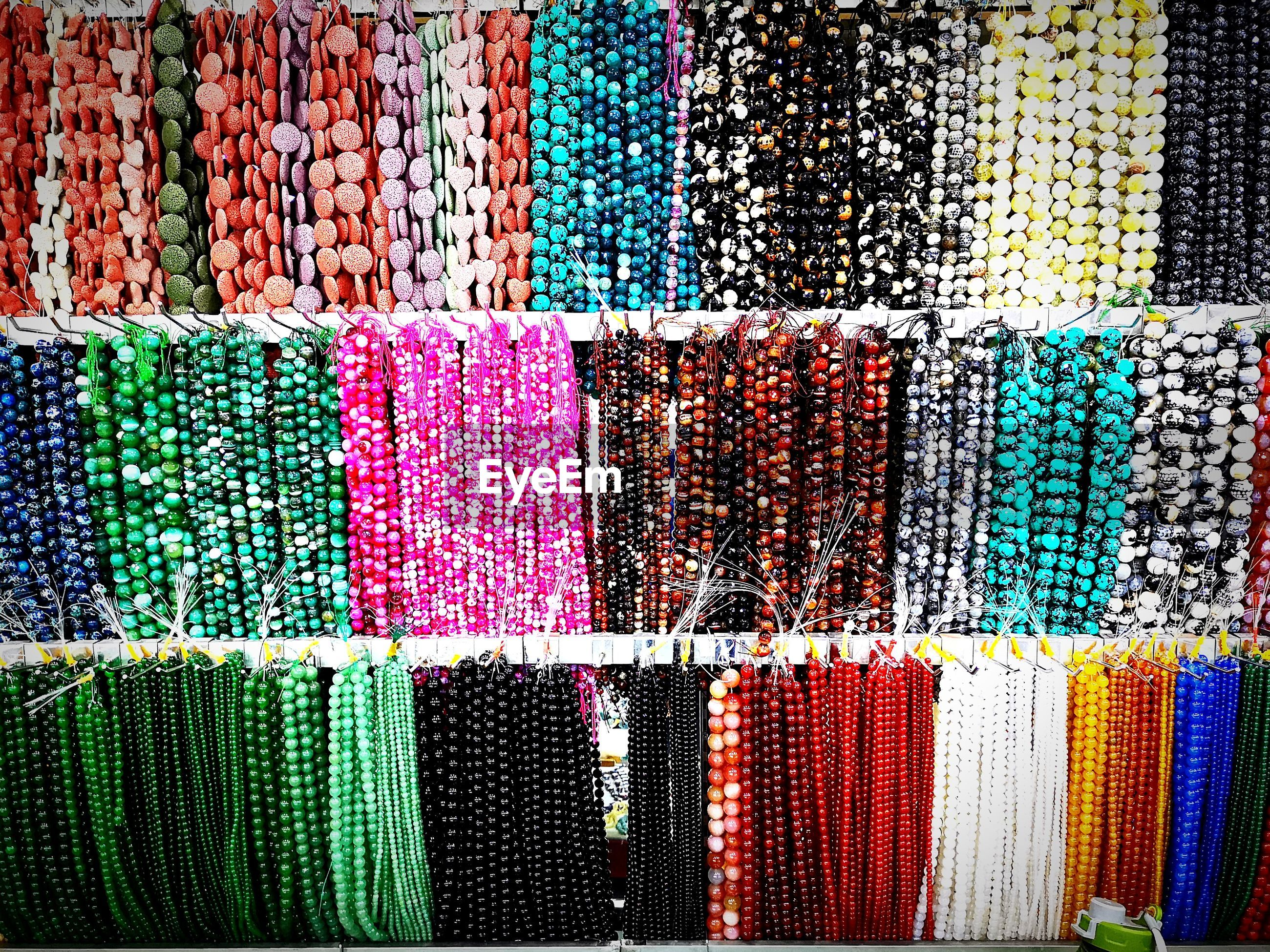 Full frame shot of colorful bead necklaces for sale at market