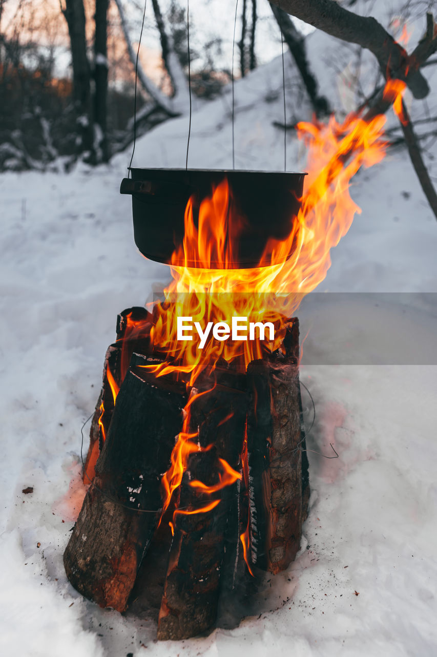 Close-Up Of Camp Fire In Snow