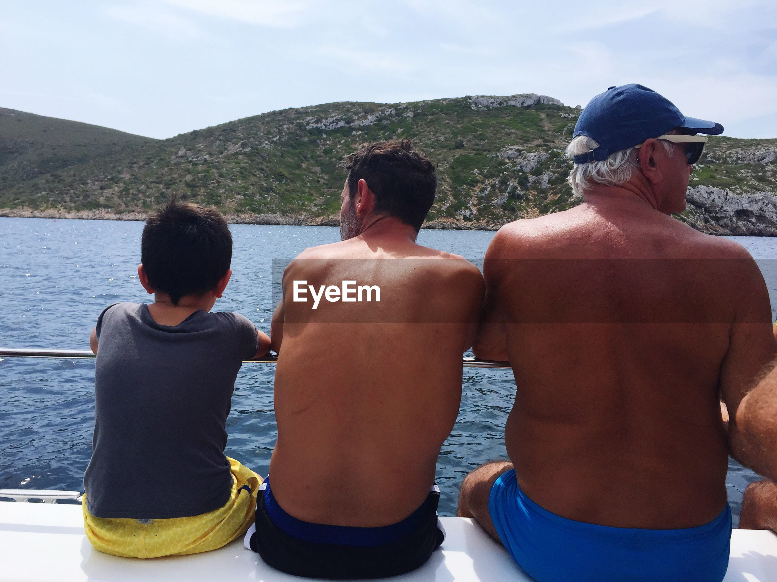 rear view, real people, shirtless, men, leisure activity, outdoors, day, lifestyles, togetherness, water, two people, standing, nature, mountain, sky, nautical vessel, people