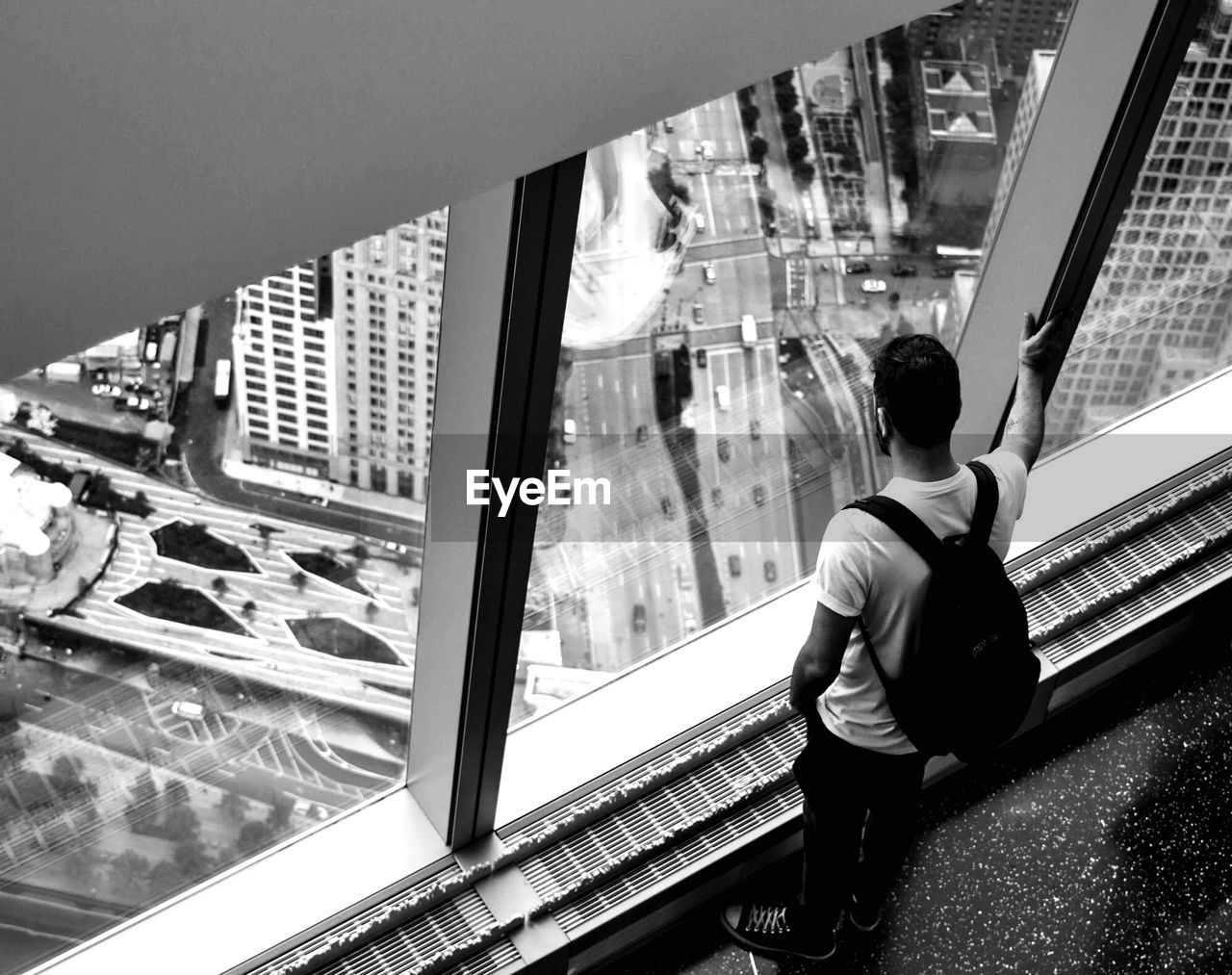 High angle view of man looking through window