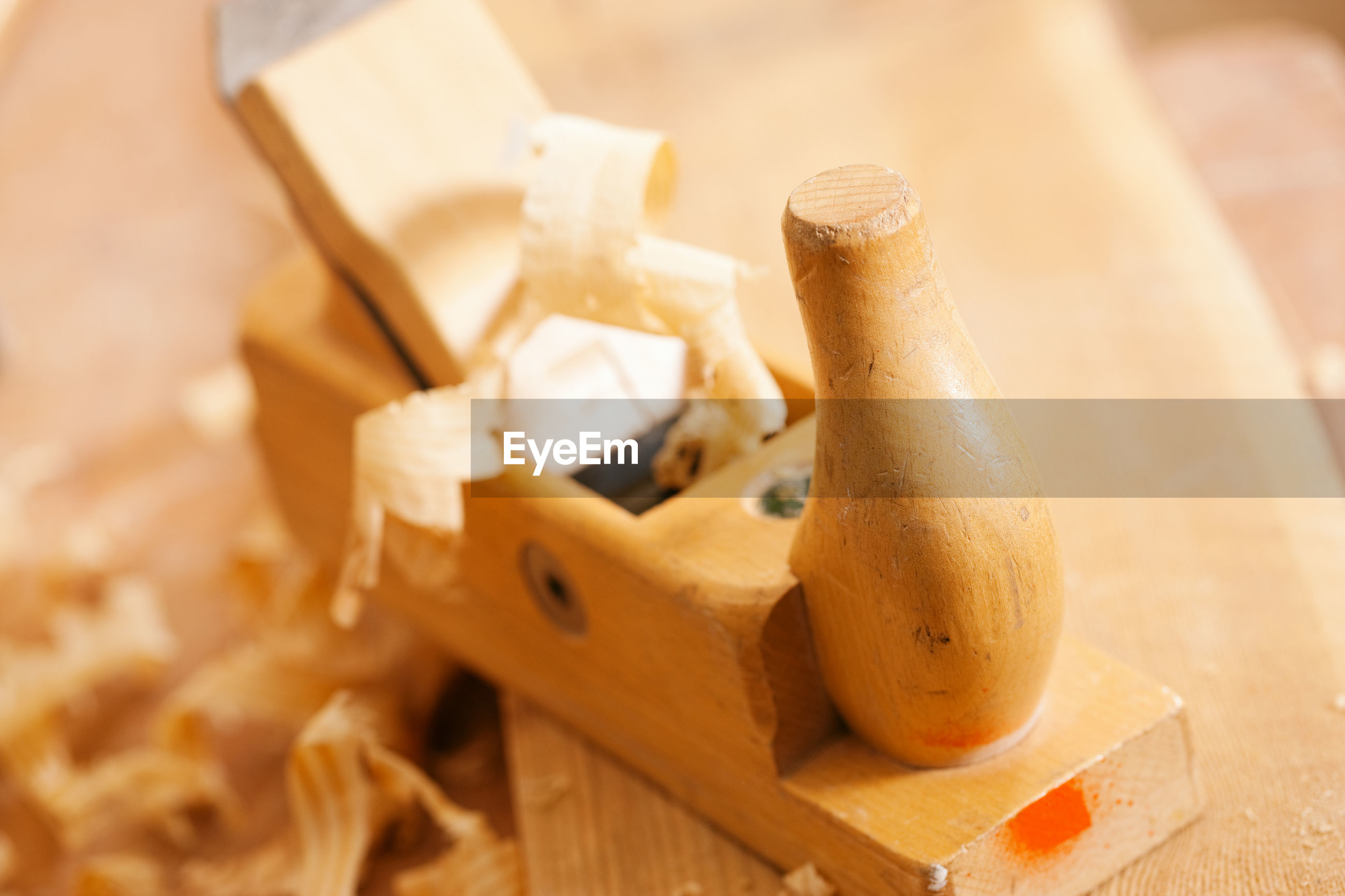 Used wood planer in the workshop of a carpenter with shavings of wood, standing on a workbench
