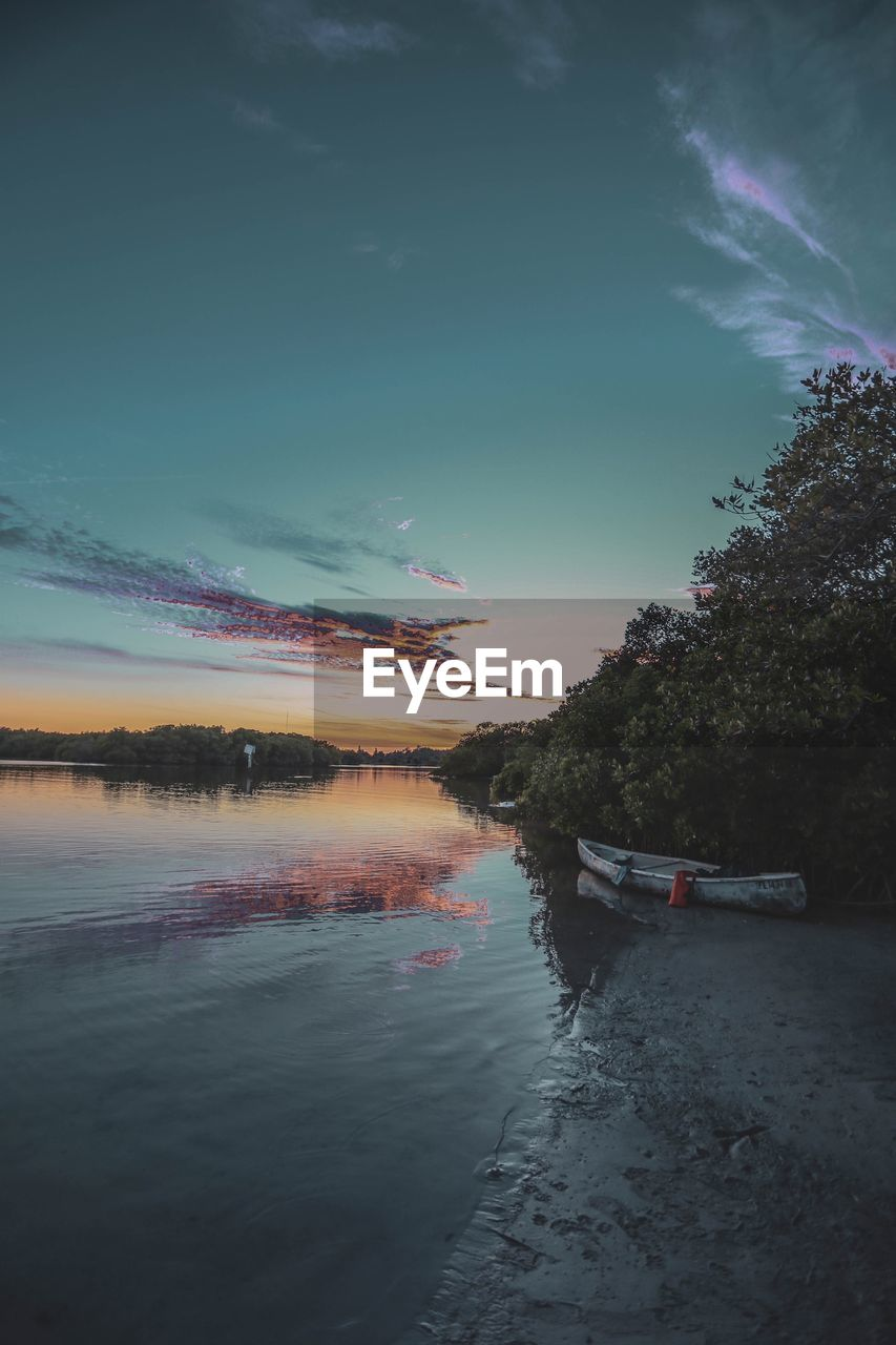 sky, water, tree, cloud - sky, nautical vessel, plant, beauty in nature, nature, transportation, sunset, scenics - nature, tranquility, mode of transportation, reflection, no people, tranquil scene, outdoors, non-urban scene, lake