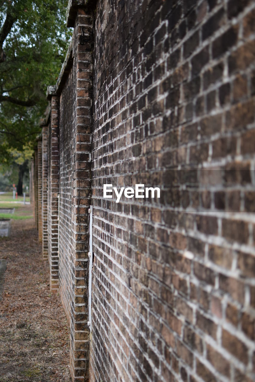 brick wall, architecture, built structure, building exterior, history, outdoors, day, no people, close-up