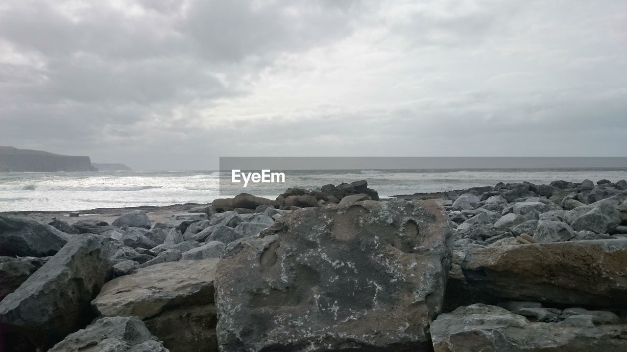 sea, sky, water, rock, scenics - nature, horizon, horizon over water, cloud - sky, land, solid, beach, beauty in nature, rock - object, nature, tranquil scene, tranquility, no people, day, motion, outdoors, rocky coastline