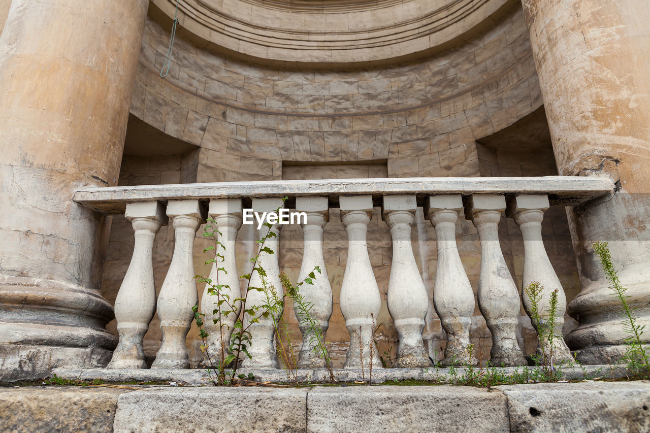 architecture, built structure, the past, history, no people, architectural column, day, building exterior, ancient, old, place of worship, religion, building, travel destinations, low angle view, railing, outdoors, belief, nature, balustrade, ancient civilization, colonnade
