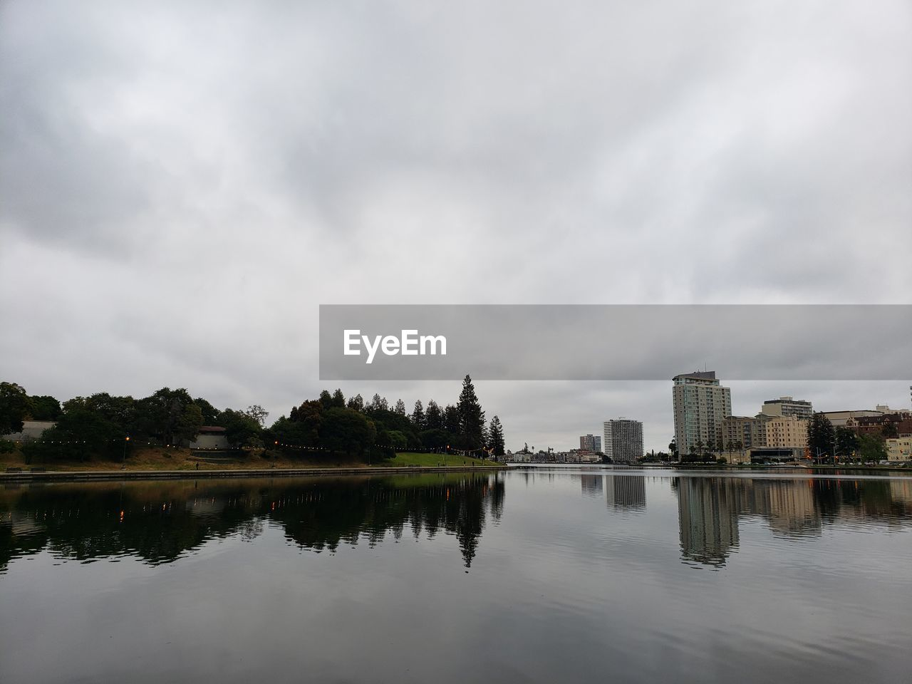 sky, architecture, cloud - sky, water, built structure, reflection, building exterior, waterfront, city, nature, lake, building, no people, tree, plant, outdoors, urban skyline, landscape, travel destinations, office building exterior, skyscraper