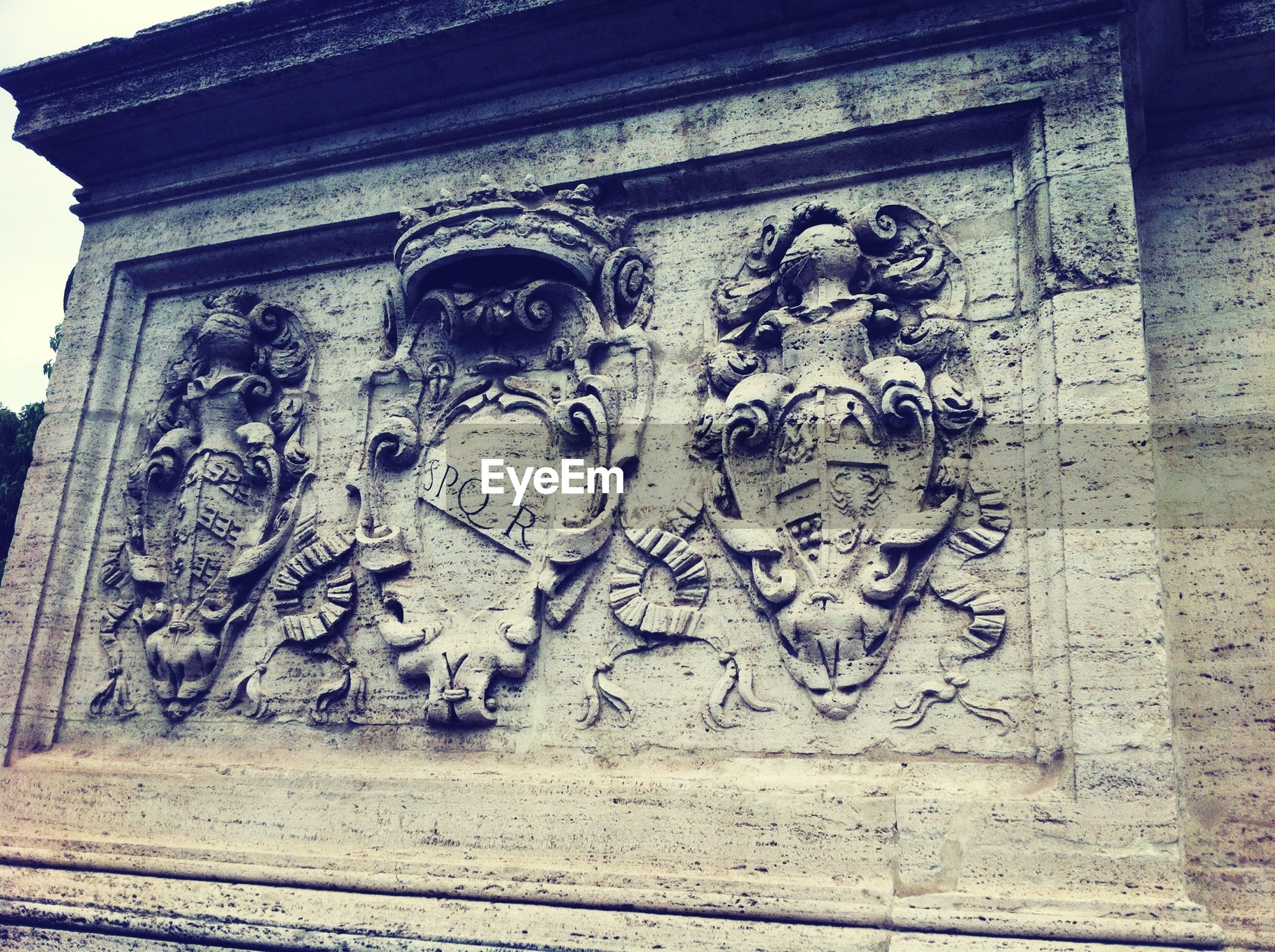 art and craft, art, creativity, architecture, human representation, built structure, building exterior, carving - craft product, low angle view, graffiti, wall - building feature, sculpture, text, statue, history, ornate, carving, old