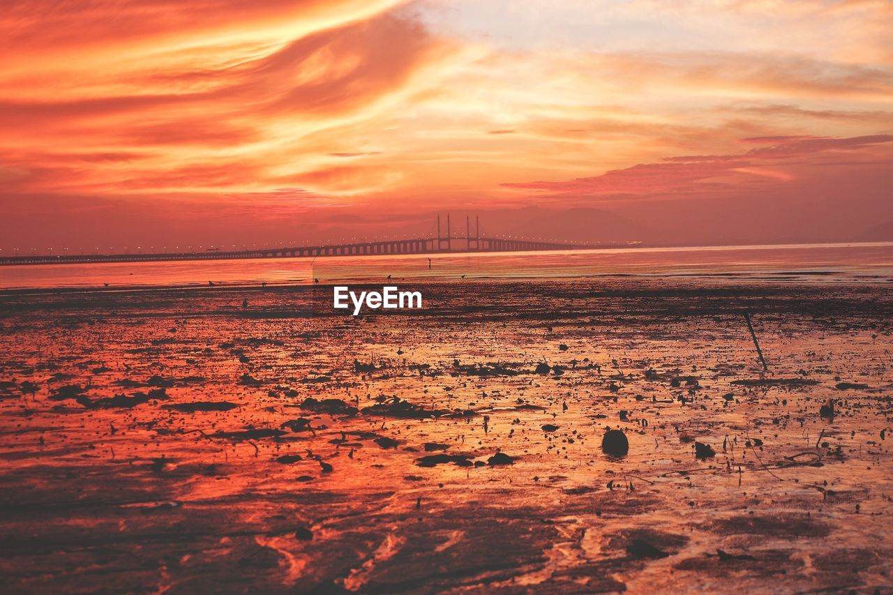 sky, sunset, cloud - sky, beauty in nature, scenics - nature, water, sea, orange color, tranquil scene, nature, no people, tranquility, horizon, idyllic, horizon over water, land, travel destinations, built structure, outdoors, bay