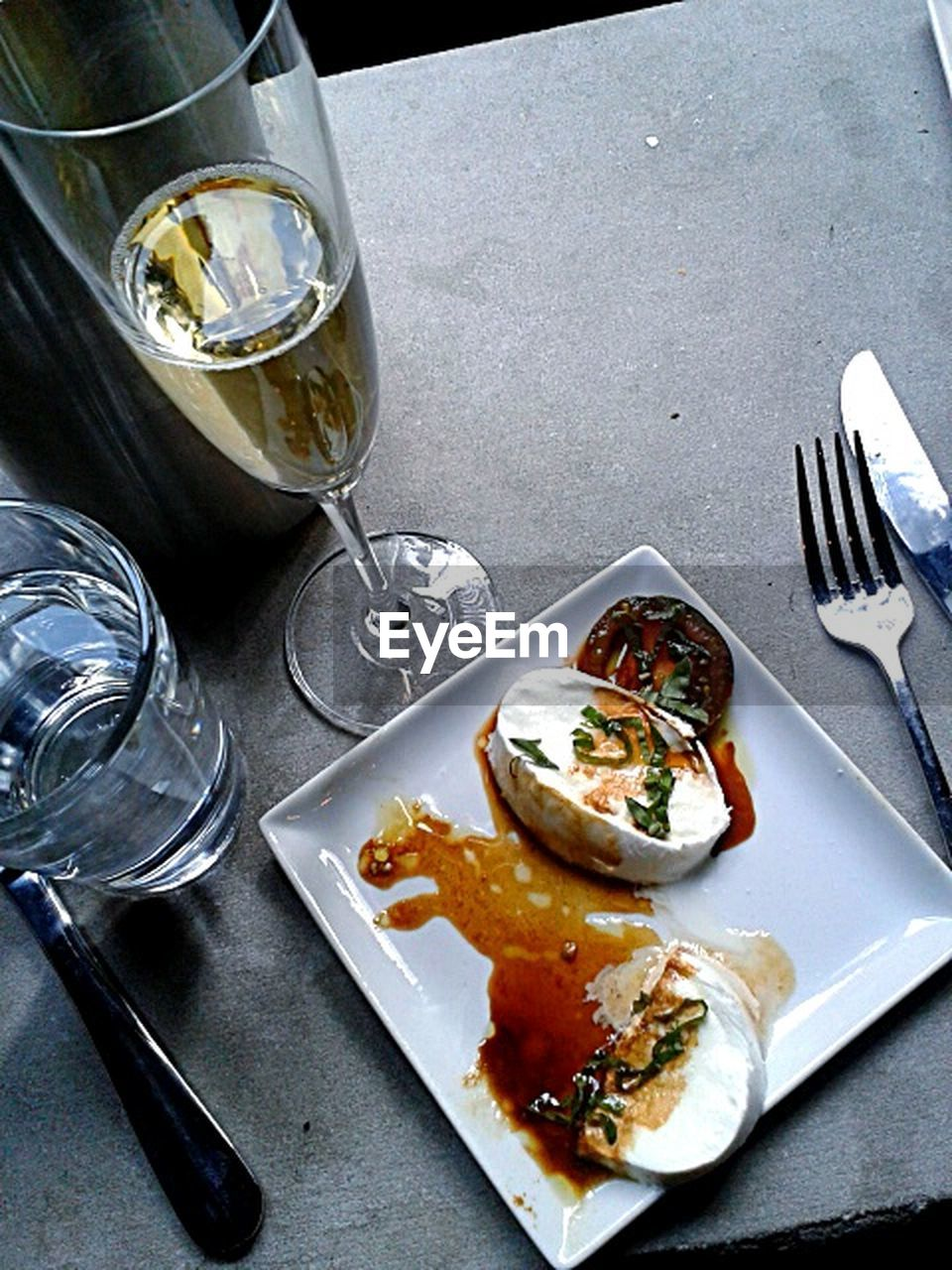 fork, food and drink, food, plate, table, drinking glass, high angle view, ready-to-eat, indulgence, no people, meal, unhealthy eating, freshness, drink, indoors, leftovers, fast food, close-up, day, eaten