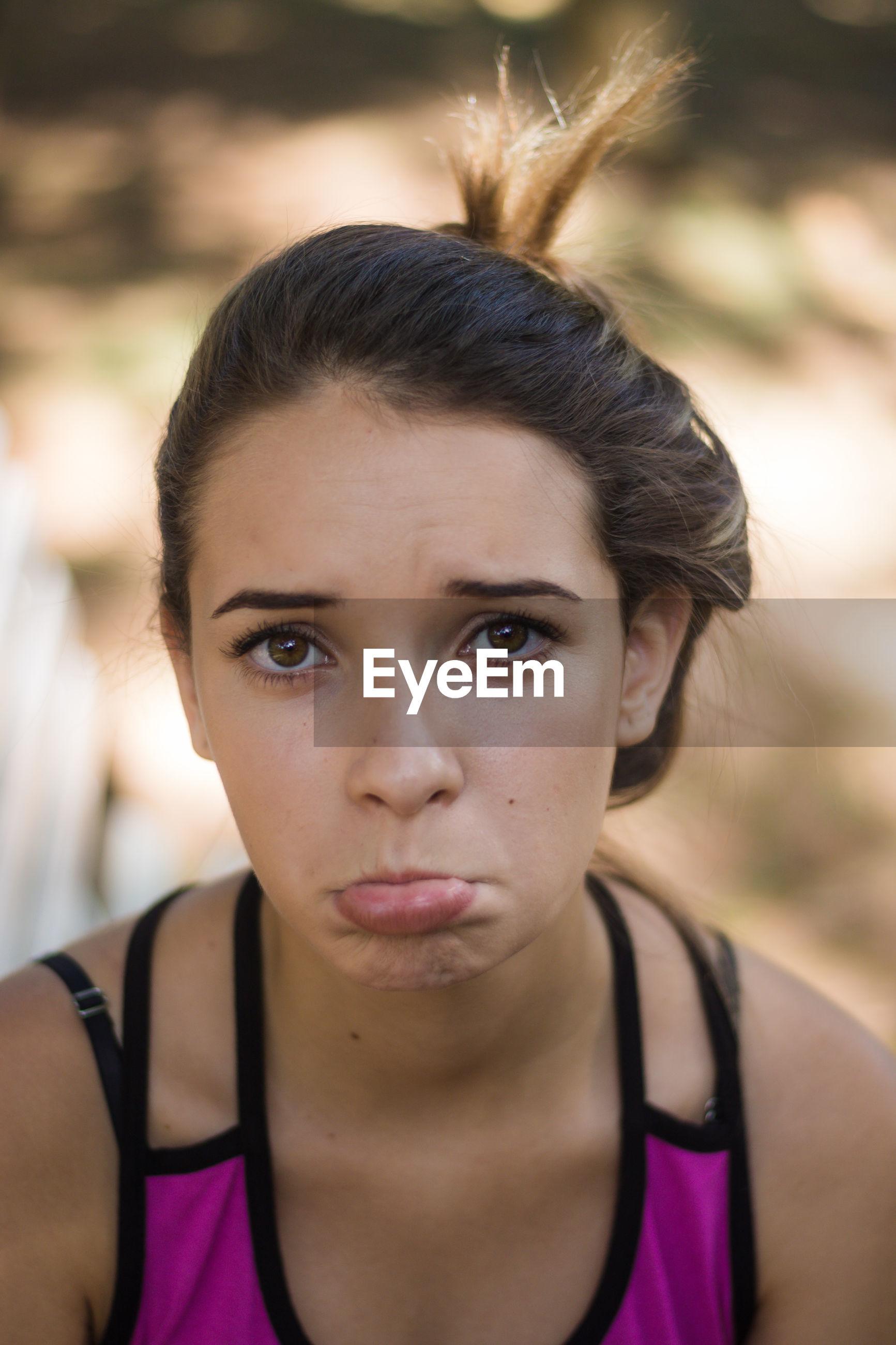 Close-up portrait of sad teenage girl at park