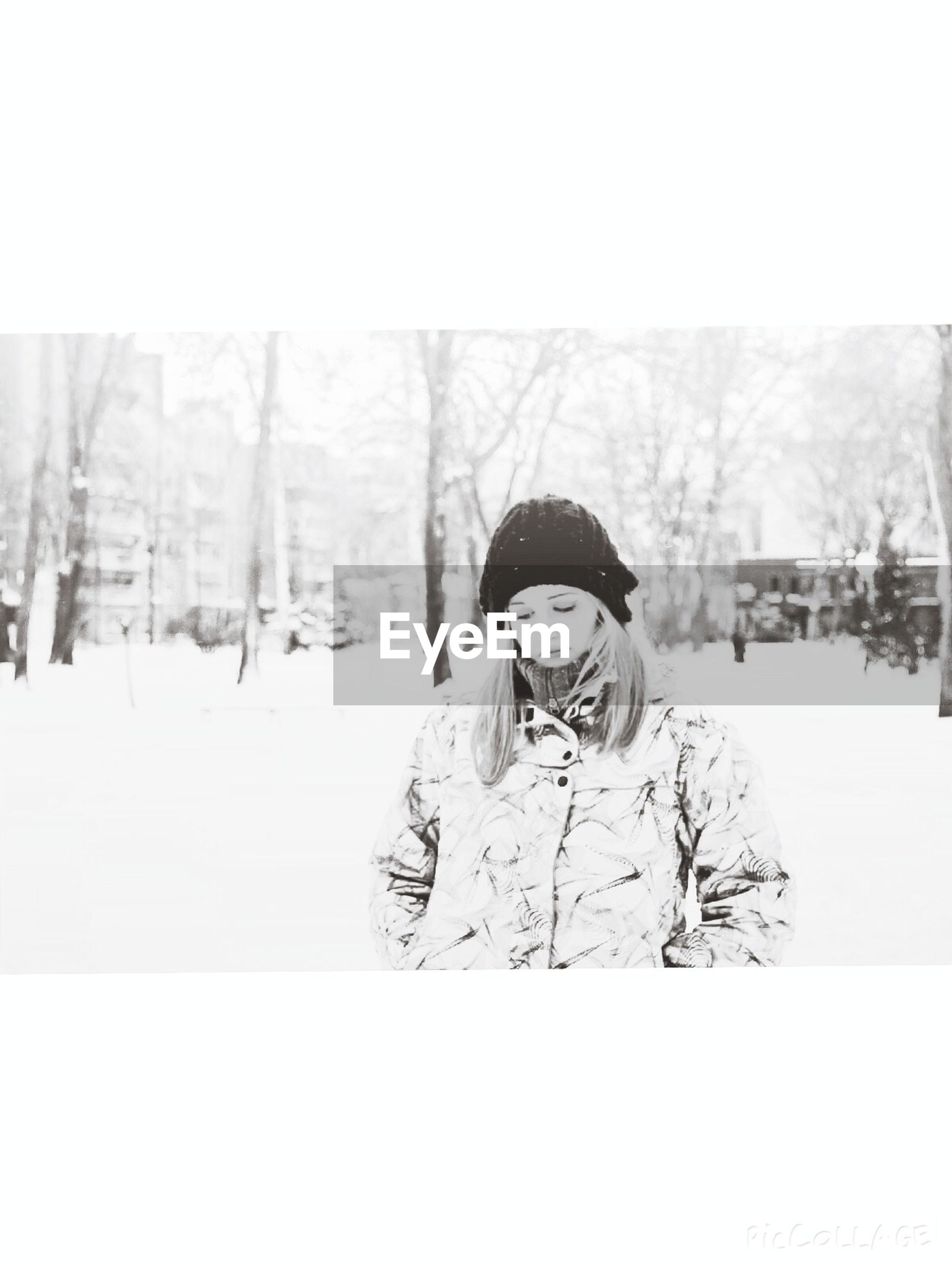 lifestyles, young adult, winter, person, cold temperature, leisure activity, looking at camera, snow, portrait, front view, casual clothing, warm clothing, season, young women, tree, standing, transfer print