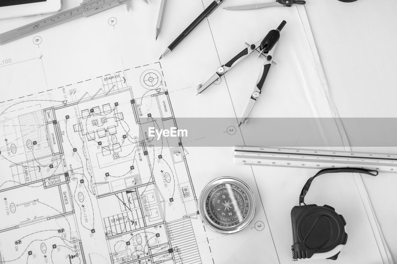 high angle view, indoors, still life, no people, pen, table, paper, accuracy, planning, plan, technology, equipment, group of objects, close-up, directly above, wall - building feature, work tool, preparation, creativity