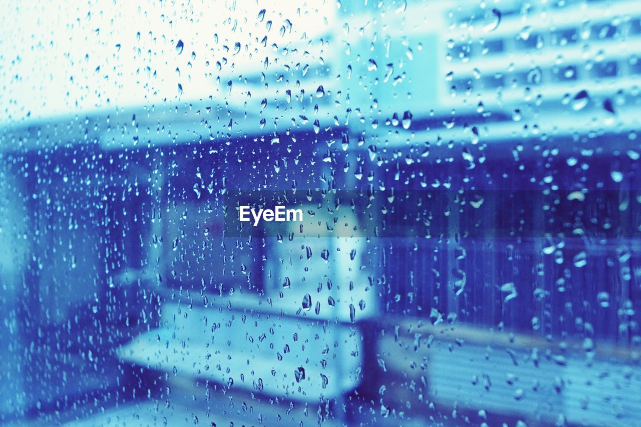rain, drop, wet, glass - material, window, water, raindrop, rainy season, weather, transparent, glass, no people, water drop, indoors, droplet, windshield, car, land vehicle, focus on foreground, day, full frame, looking through window, transportation, close-up, car interior, backgrounds, nature, architecture, sky